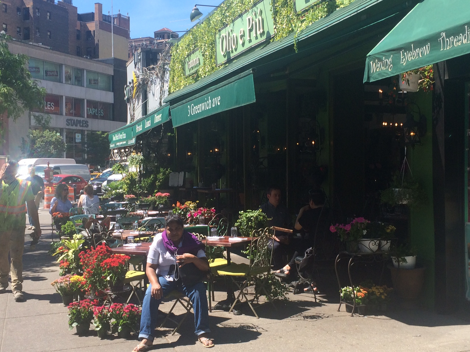A flower market spills over into a restaurant patio